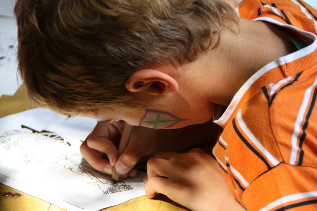 helping your child write better - boy writing | From the blog of Nicholas C. Rossis, author of science fiction, the Pearseus epic fantasy series and children's books