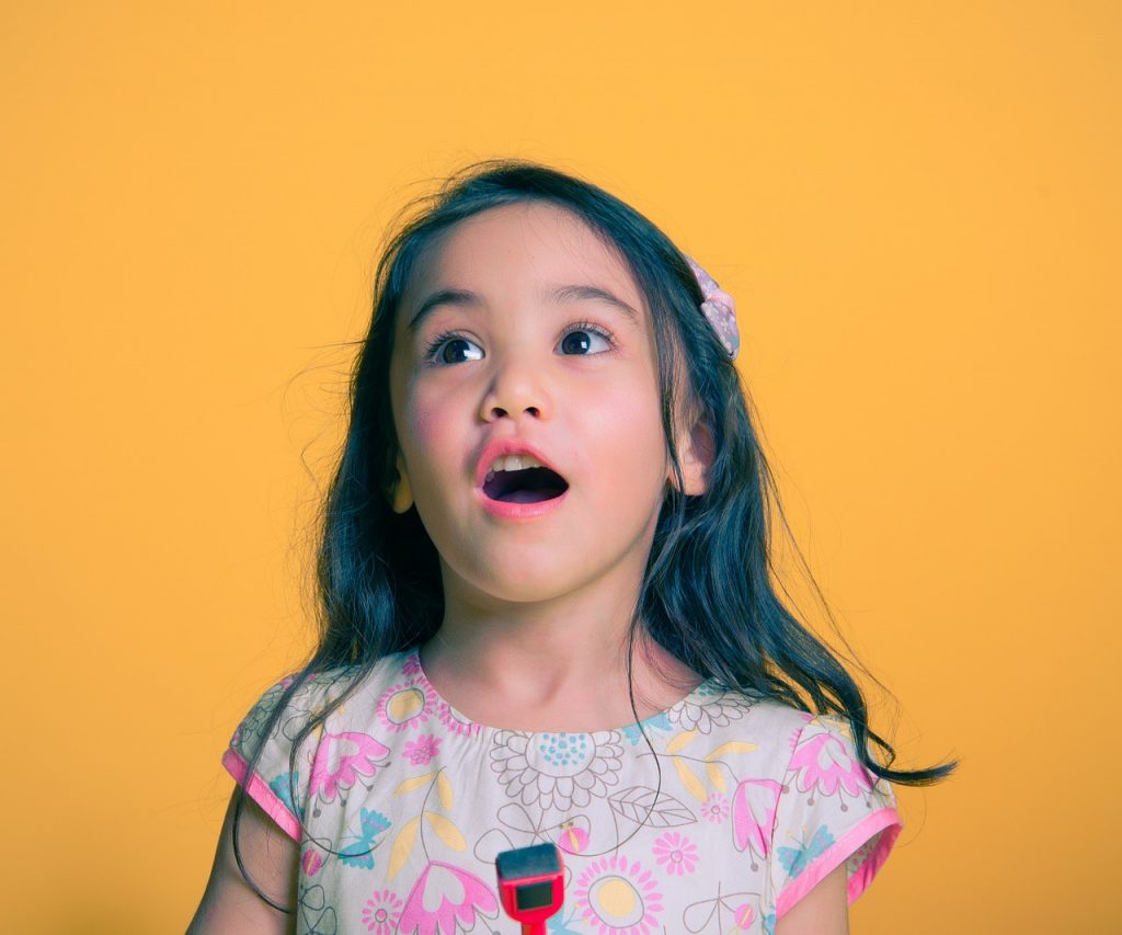 helping your child write better - girl singing | From the blog of Nicholas C. Rossis, author of science fiction, the Pearseus epic fantasy series and children's books
